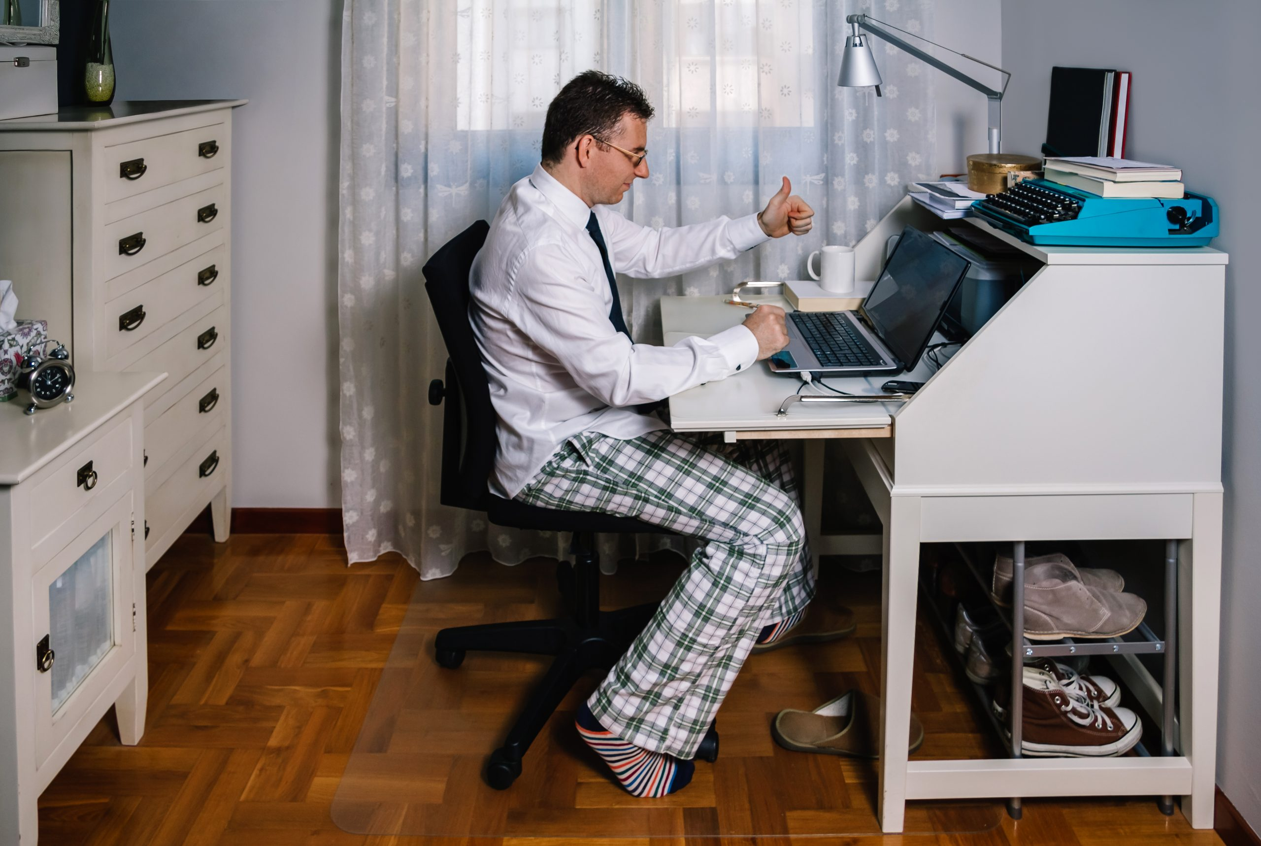 Man at desk in pajams and shirt and tie
